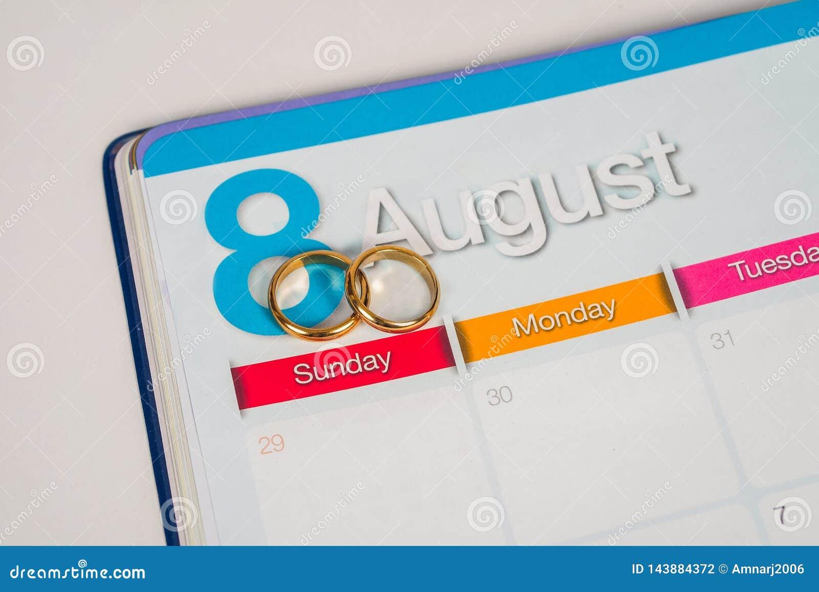 Gold Wedding ring on calendar planning