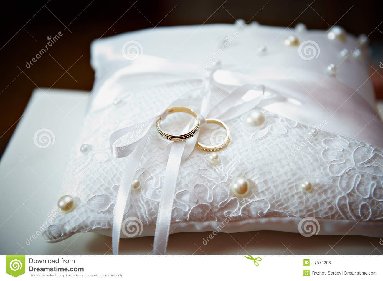 gold wedding ring on pillow with pearl stock photo image