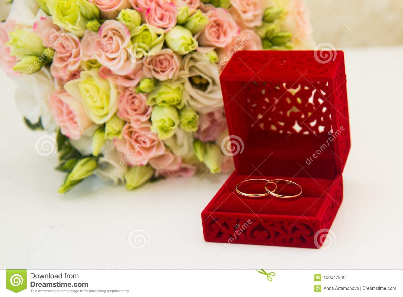 Gold Wedding Ring, A Red Box And A Flower Bouquet Of The Bride Stock ...