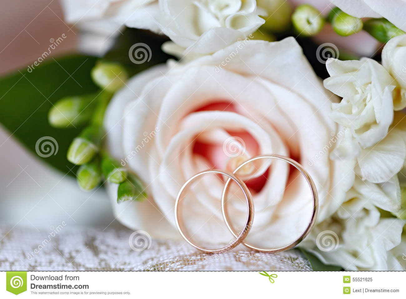 Gold Wedding Rings On Bouquet Of Flowers For The Bride Stock Image ...