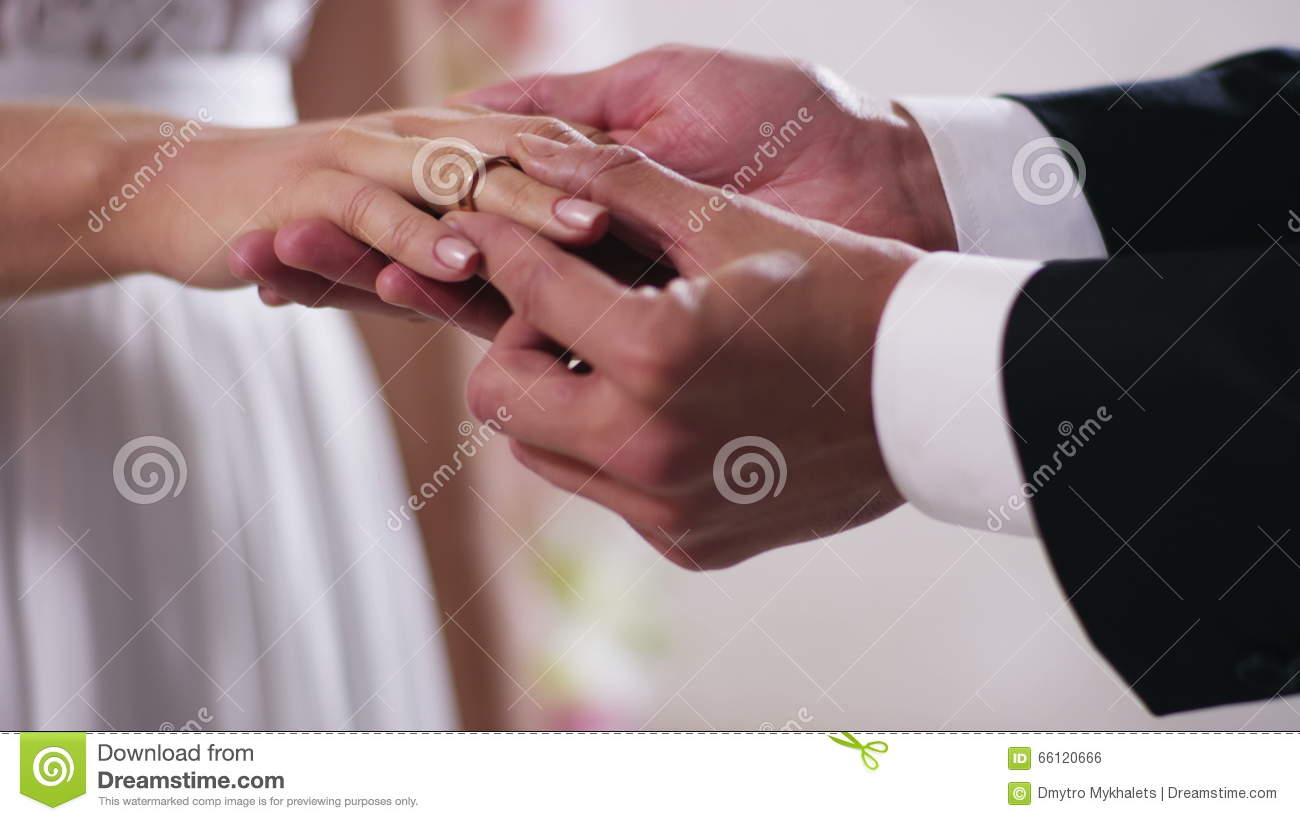 Gold Wedding Rings And Hands Of Just Married Couple Close Up On Hand