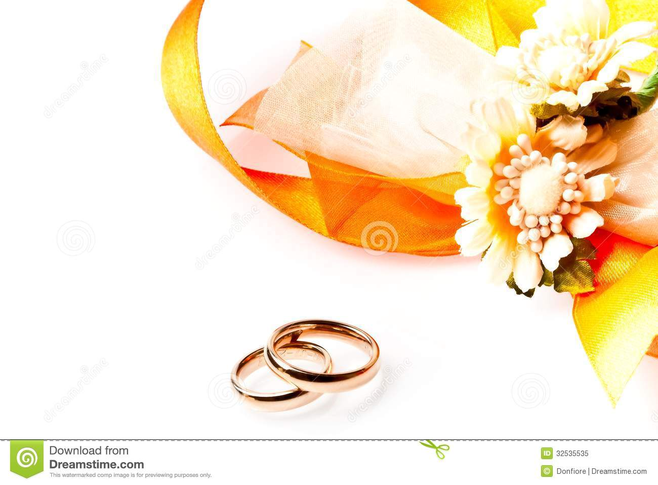 Gold Wedding Rings Near Ribbon And Flowers With Space For ...