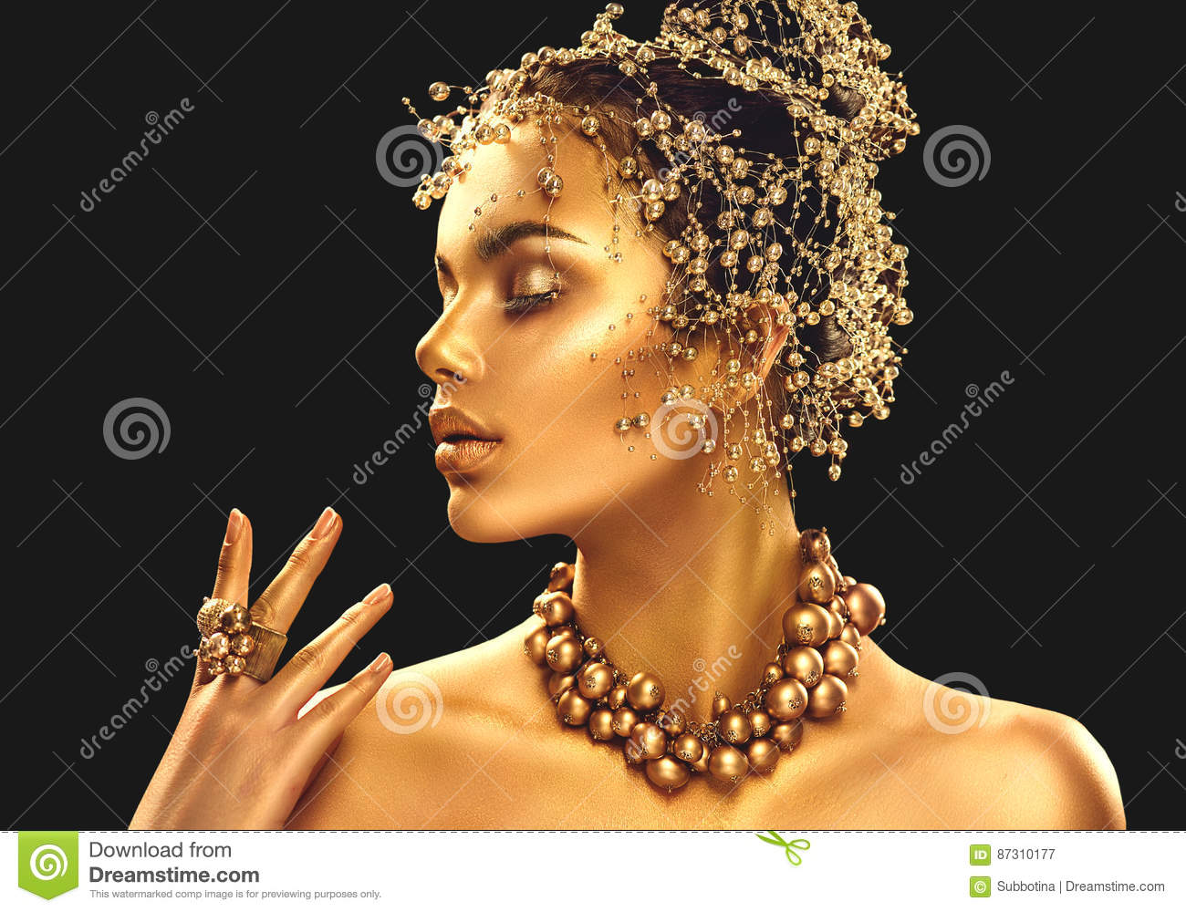 Gold Woman Skin. Beauty Fashion Model Girl With Golden