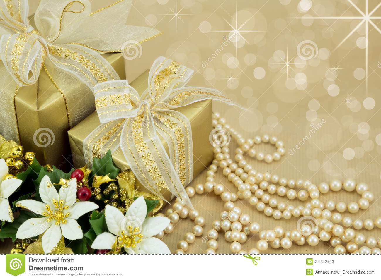 Gold Wrapped Presents With Pearls And Flowers Stock Image