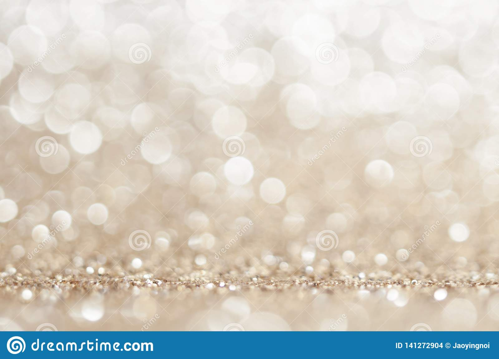 Gold, yellow abstract light background, Pink Gold bokeh shining lights, sparkling glittering Christmas lights.Season greeting bac