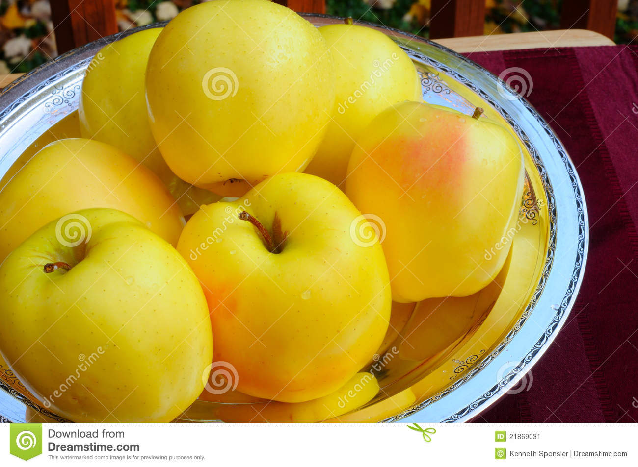 golden apples on silver stock image