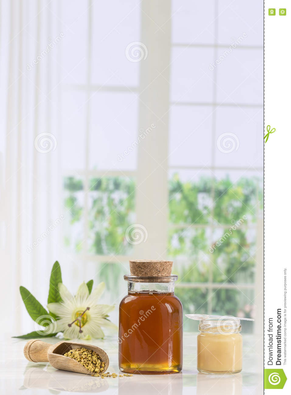 Golden Bee Pollen In Small Glass Jars With Royal Jelly And In A The