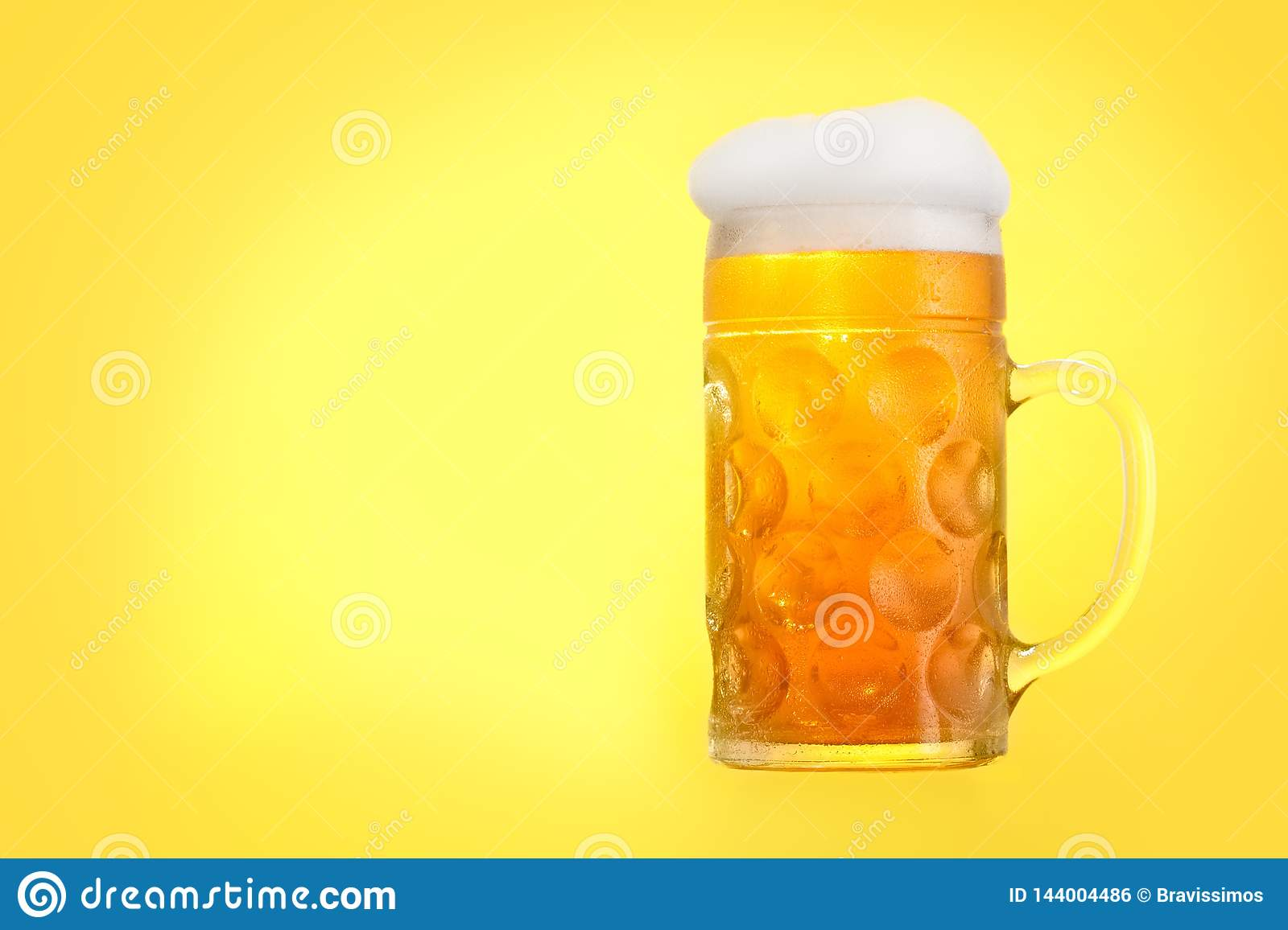 Golden beer in glass with foam, alcohol beverage,  pint