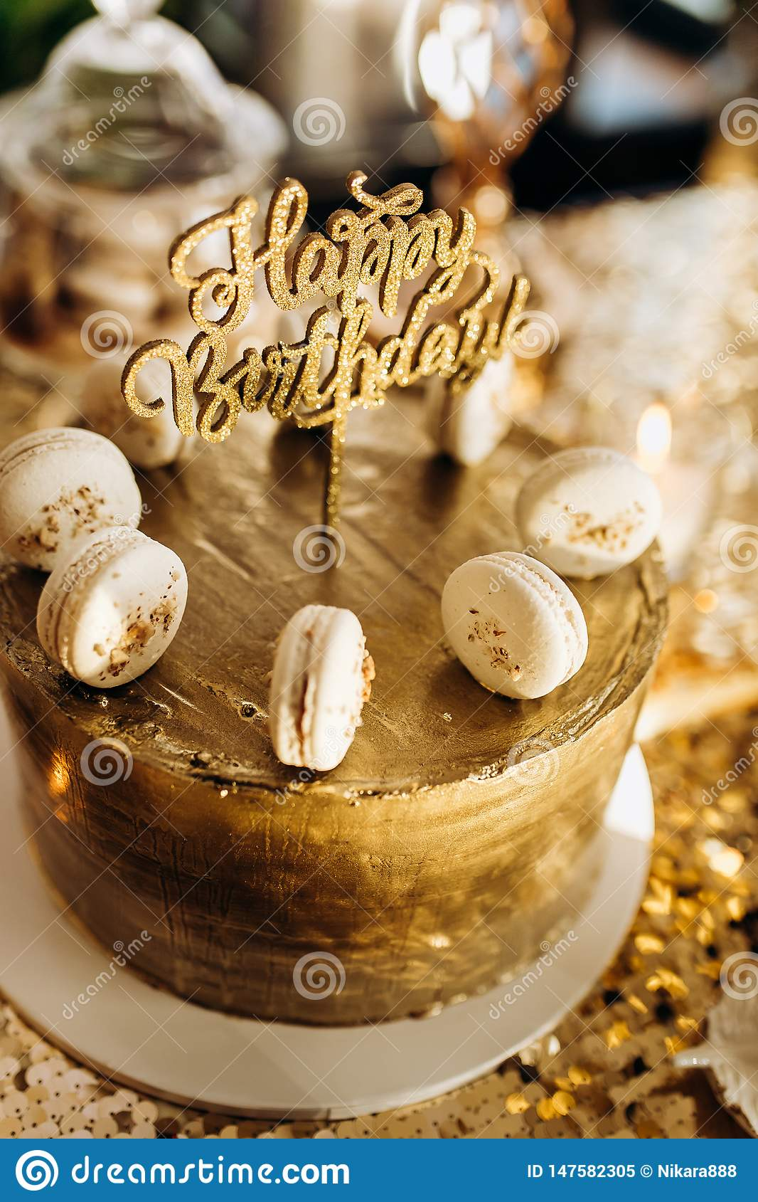 Wondrous A Golden Birthday Cake Is Decorated With Macaroni Stock Image Funny Birthday Cards Online Alyptdamsfinfo
