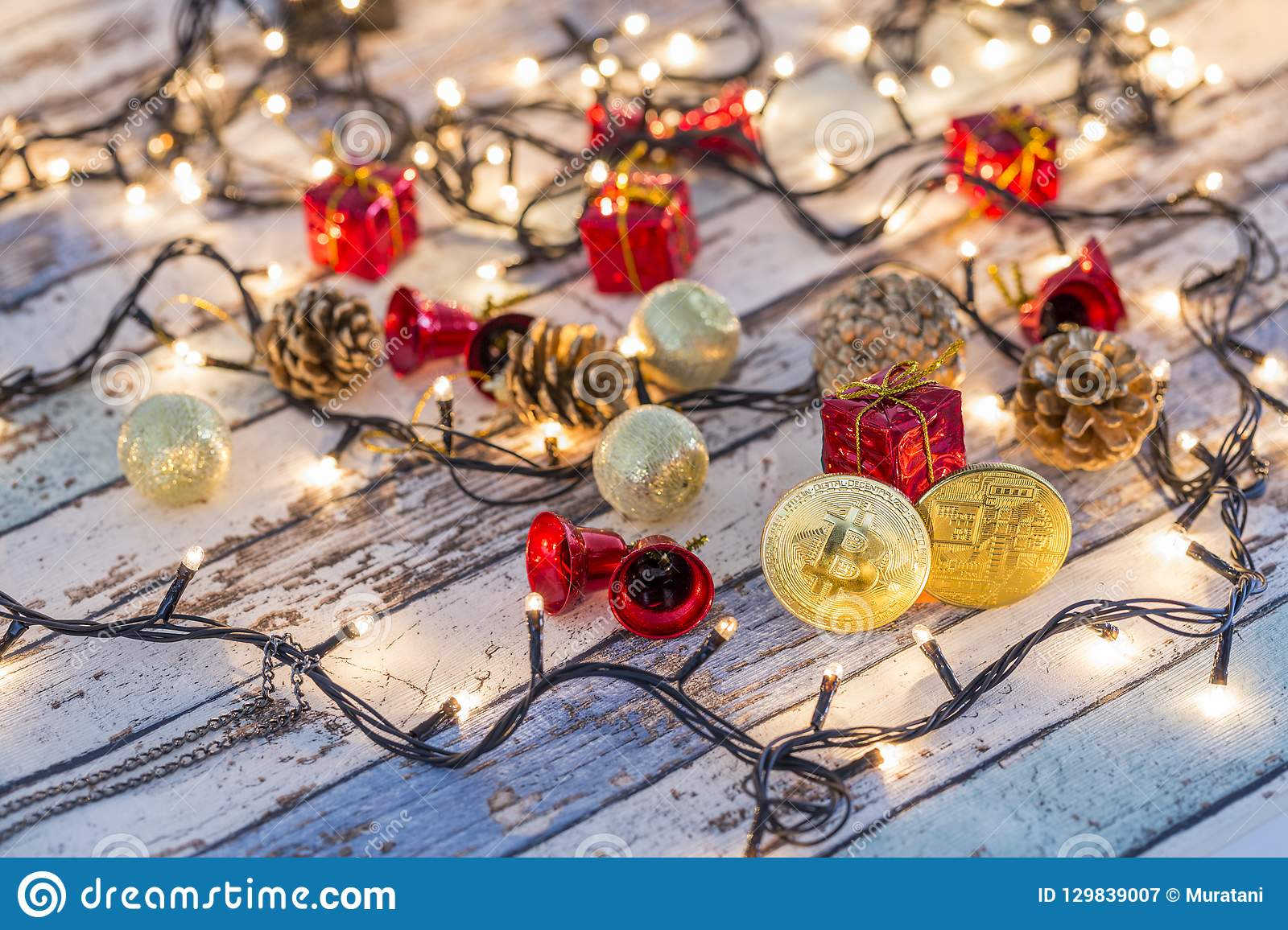 Golden bitcoin and another bitcoin in back with christmas decors