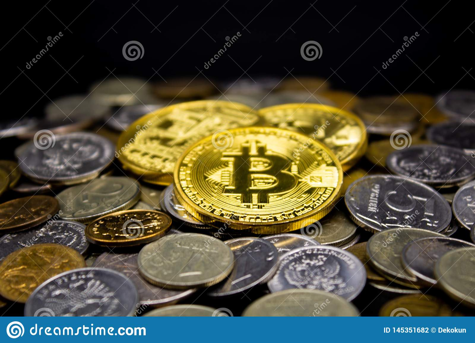 Coins on a black background