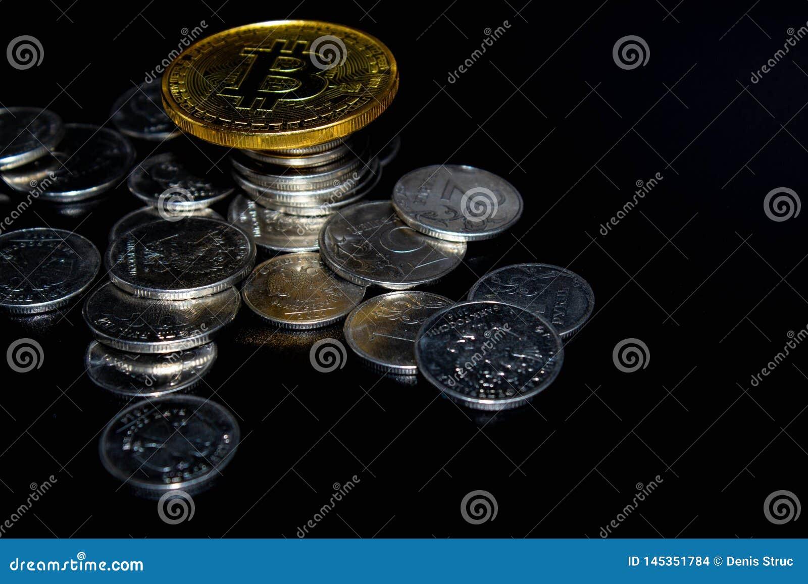 Golden Bitcoin on a black background, money