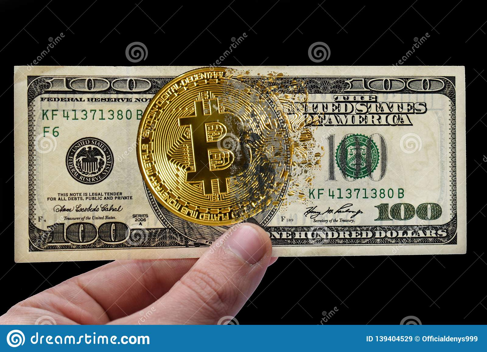 Golden bitcoin and us dollars in hand. The coin is crumbling. The concept of cryptocurrency in the market crisis. Black background