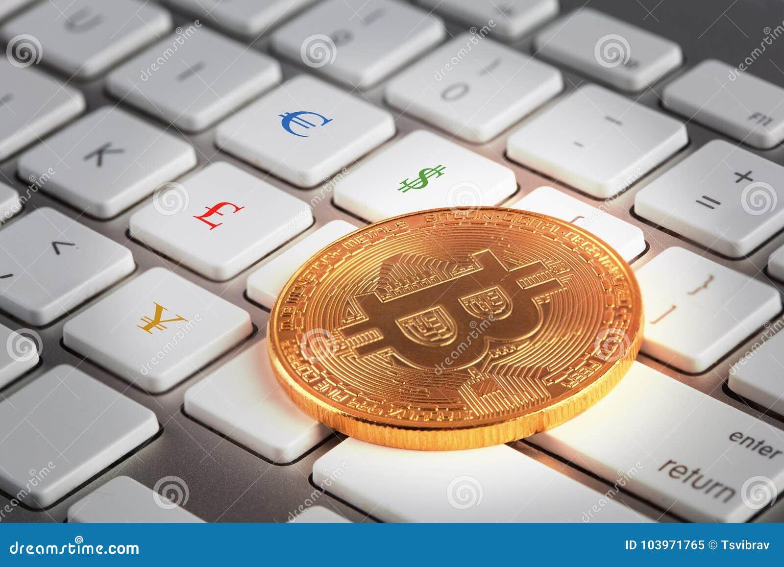 Golden Bitcoin On White Keyboard With Euro Dollar Pound And Yen