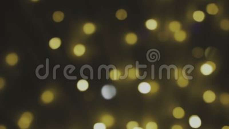 Golden, blurred, bokeh lights background  Abstract sparkles  Full HD loop,  1080p  Defocused, magic