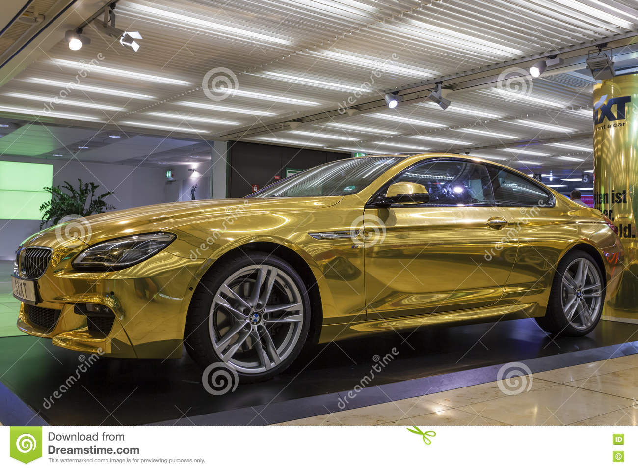 golden bmw at the frankfurt airport editorial stock photo image 75013983. Black Bedroom Furniture Sets. Home Design Ideas