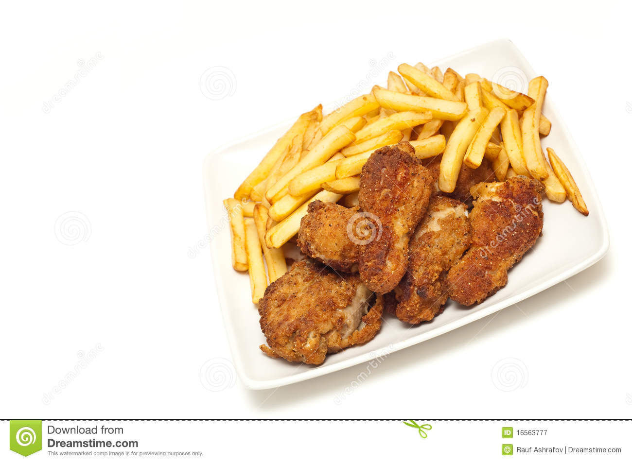 Golden brown fried chicken served with fries