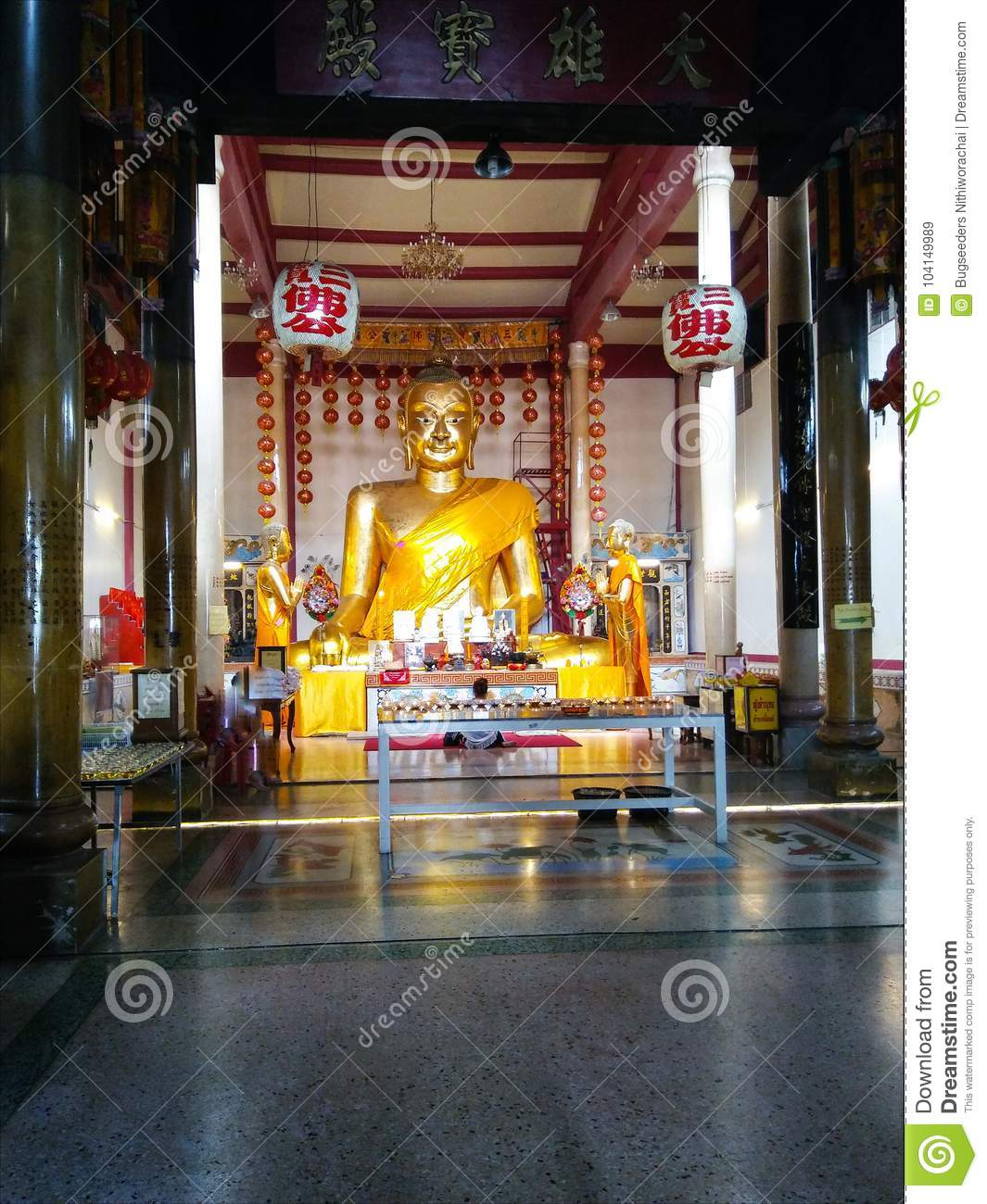 Golden Buddha And Disciples Statue In Templeinese Langue Is