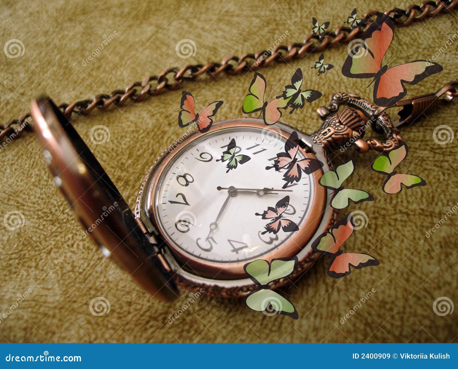 Golden clock with butterflies