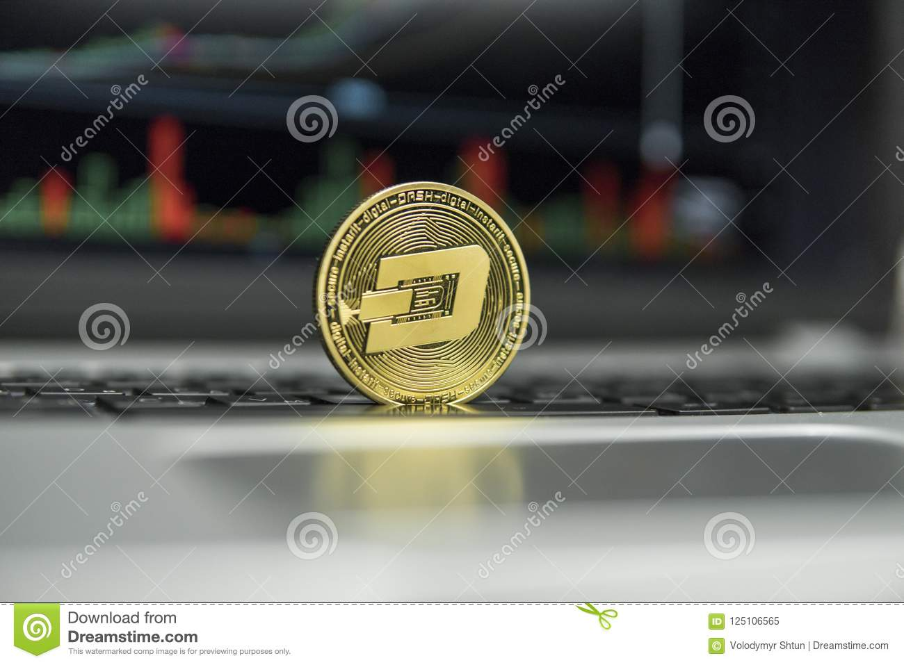 Golden Dash Coin On A Black Keyboard Of Silver Laptop And Diagram Chart Graph