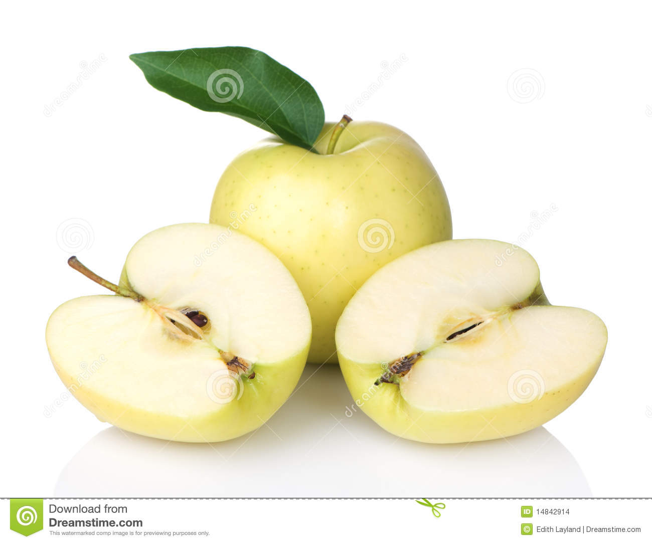 Golden Delicious Apples With One Sliced in Half