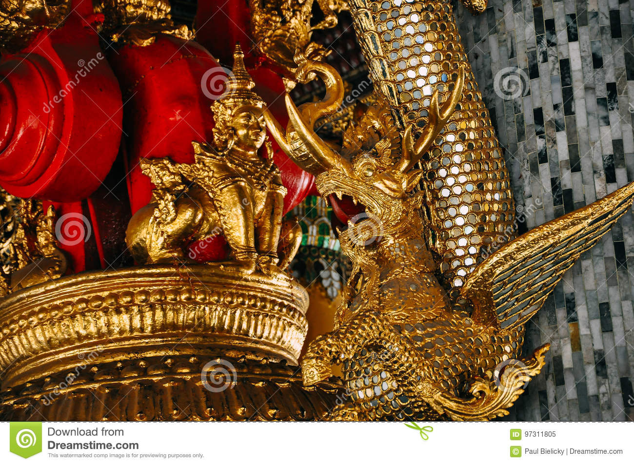 A golden dragon in a temple in Yangon.