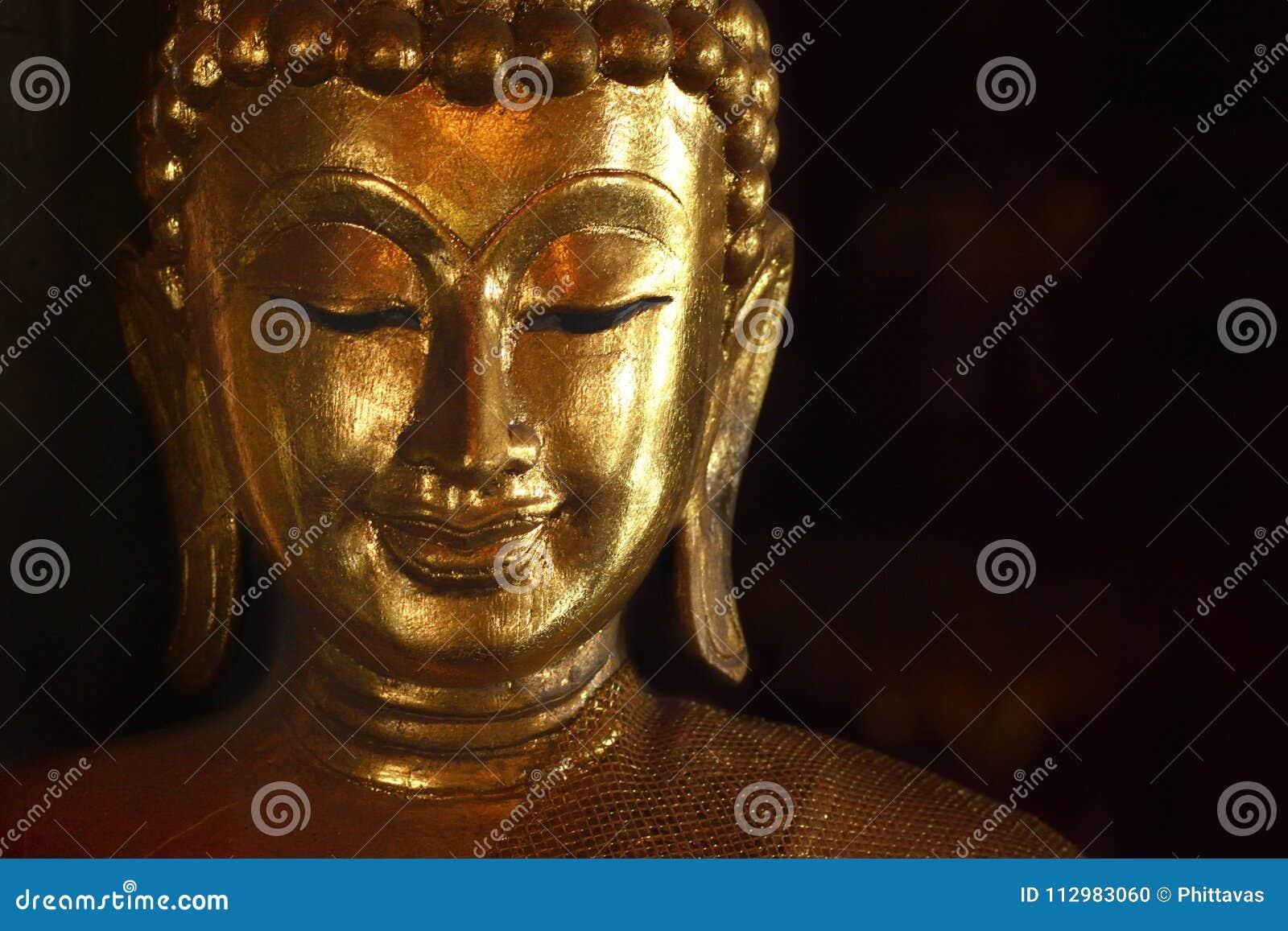 Golden face of buddish state in the art style ,Wat Krathum Suea Pla temple ,Bangkok