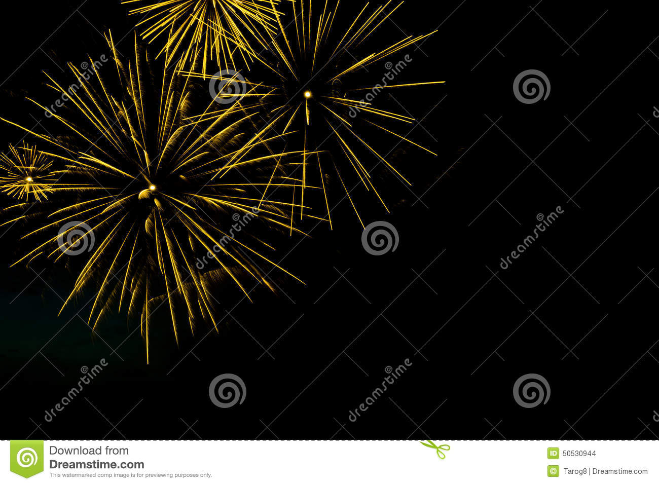 Golden fireworks border on the black sky background with copyspace