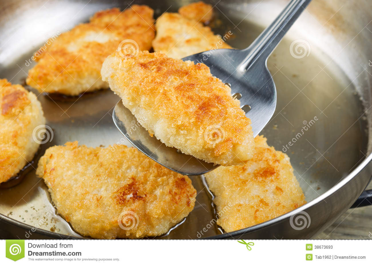 Golden fried fish in pan stock image image of healthy for Breaded pan fried fish
