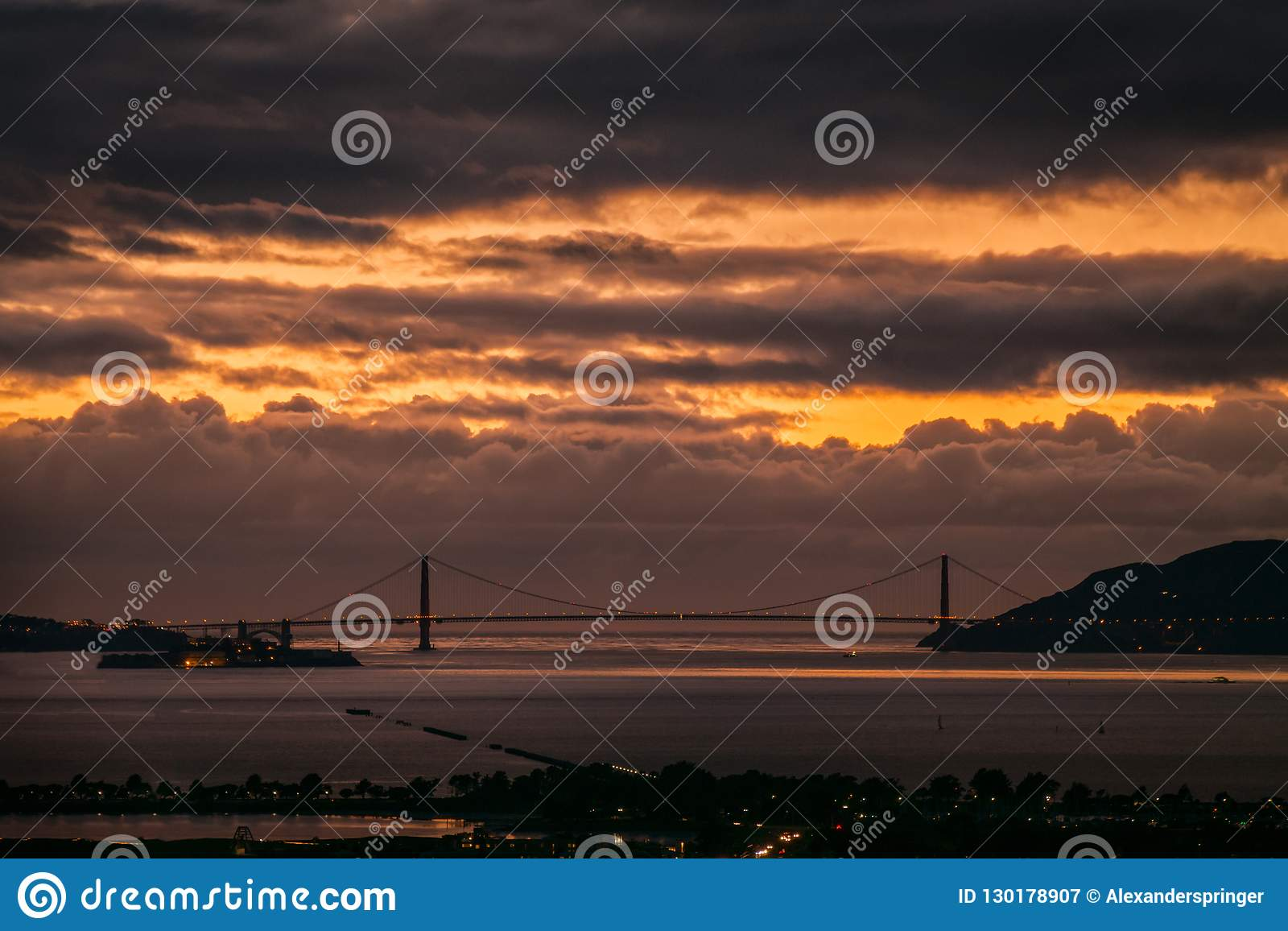 Golden Gate Bridge at sunset with thick moody clouds