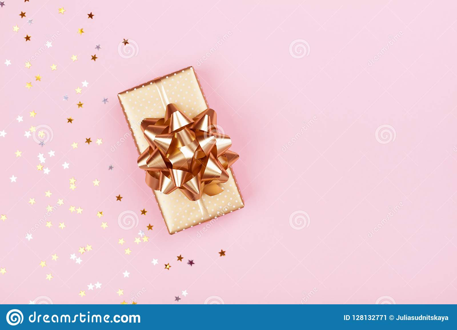 Golden Gift Or Present Box And Stars Confetti On Pink Background Top View Flat Lay Composition For Birthday Christmas Wedding