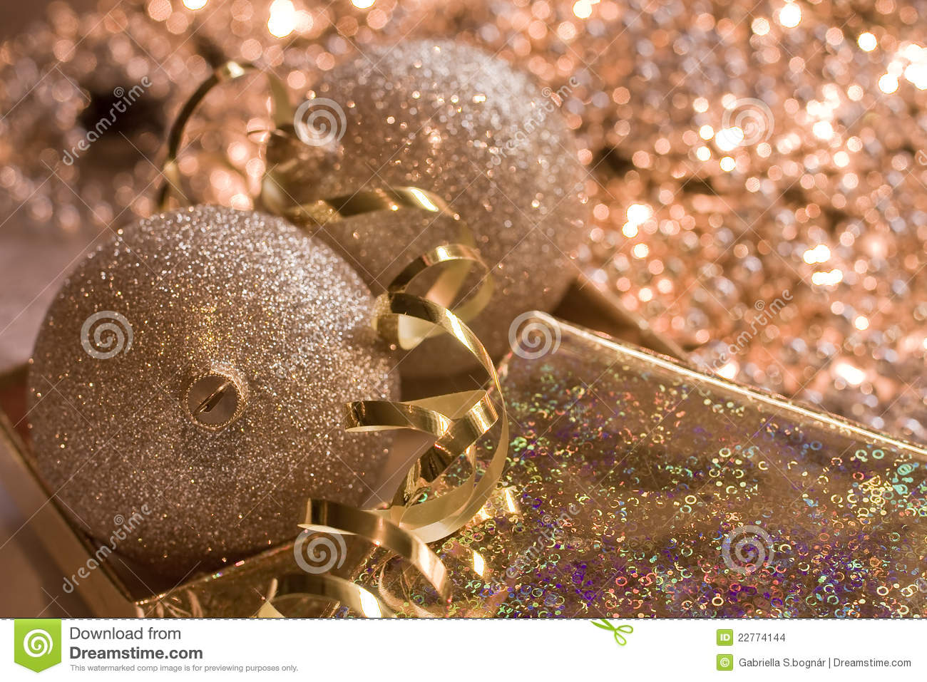 Golden glass spheres in Christmas bright backgroun