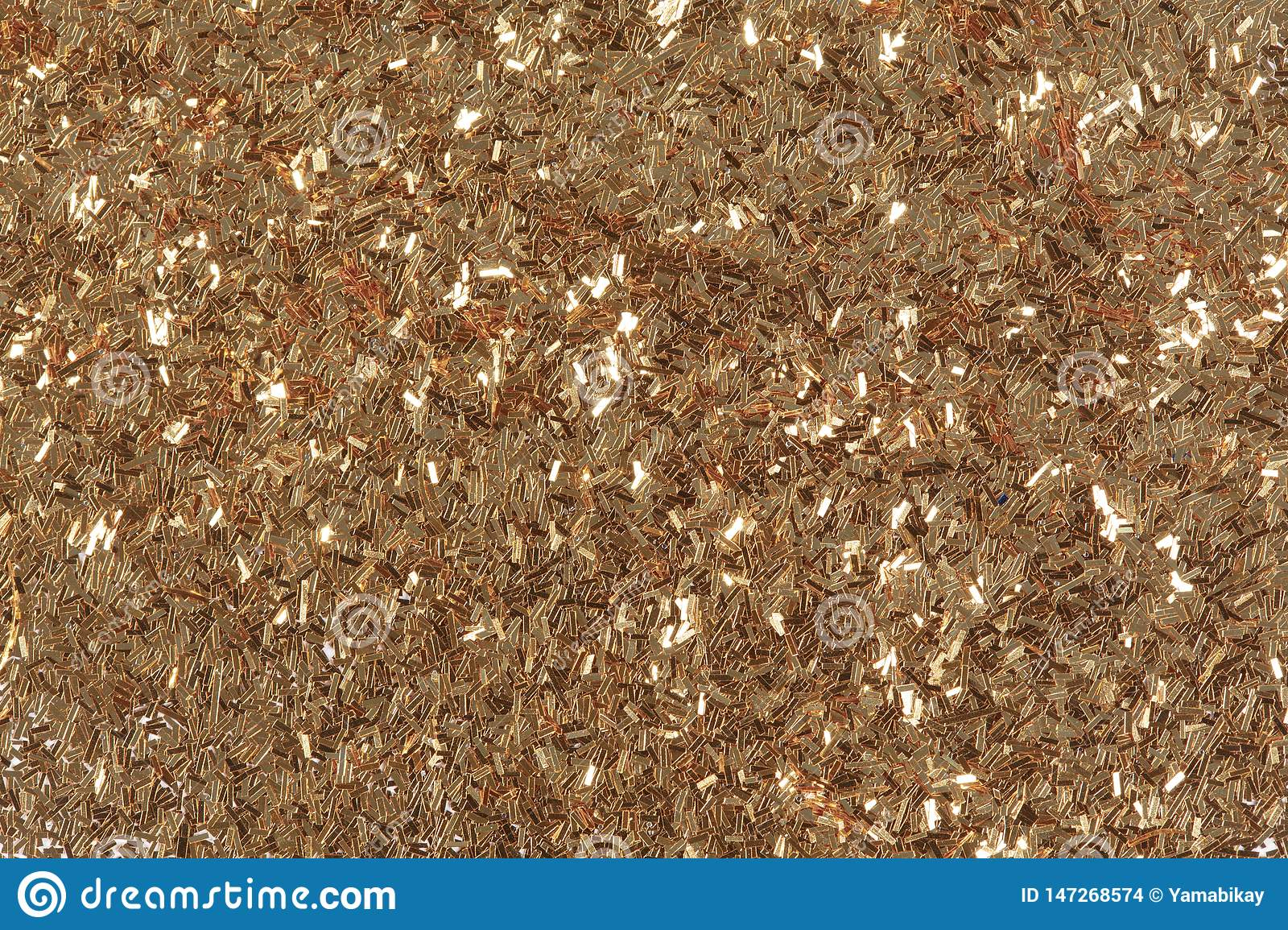 Golden glitter texture, abstract background. Bright exclusive texture, pattern. Low contrast photo.