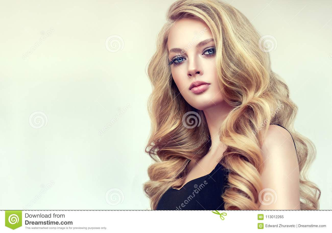 Golden Haired Woman With Voluminous Shiny And Curly