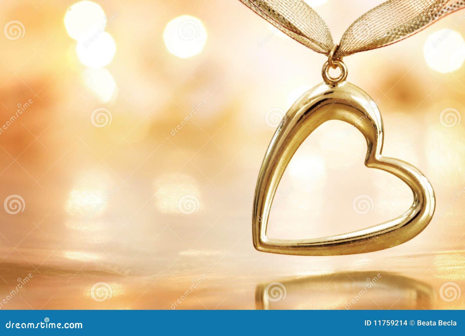 Golden heart on defocused lights background