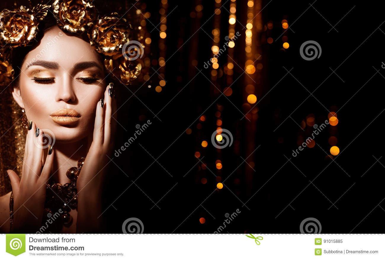 Golden holiday hairstyle, manicure and makeup. Golden wreath and necklace