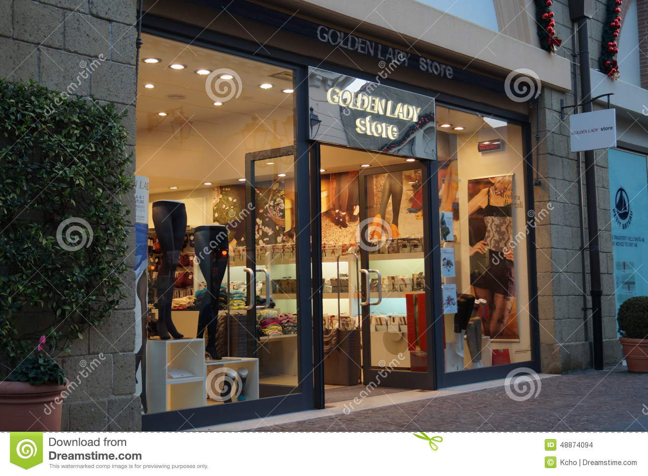 Golden Lady store editorial stock image. Image of golden - 48874094