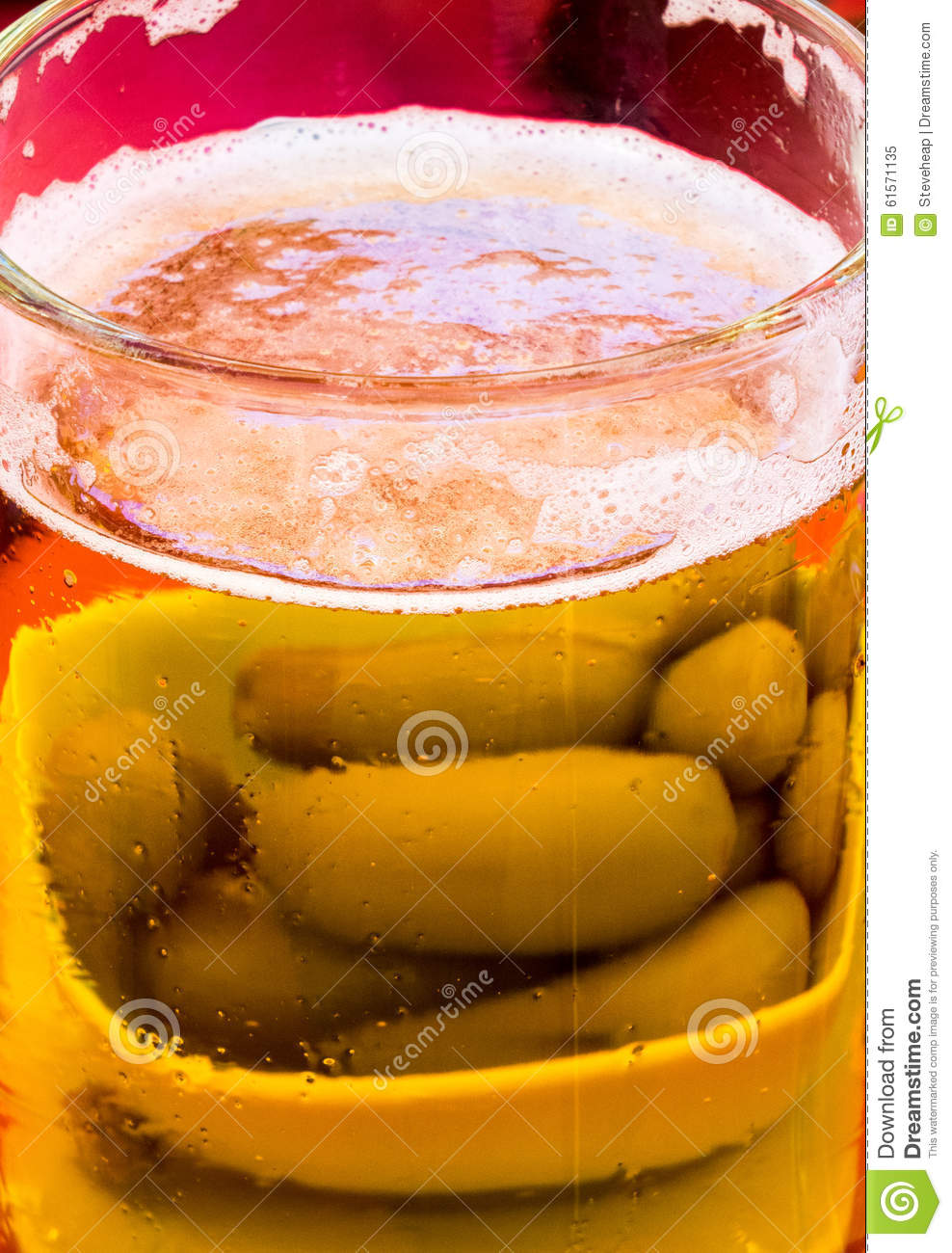 Golden lager or beer with green olives
