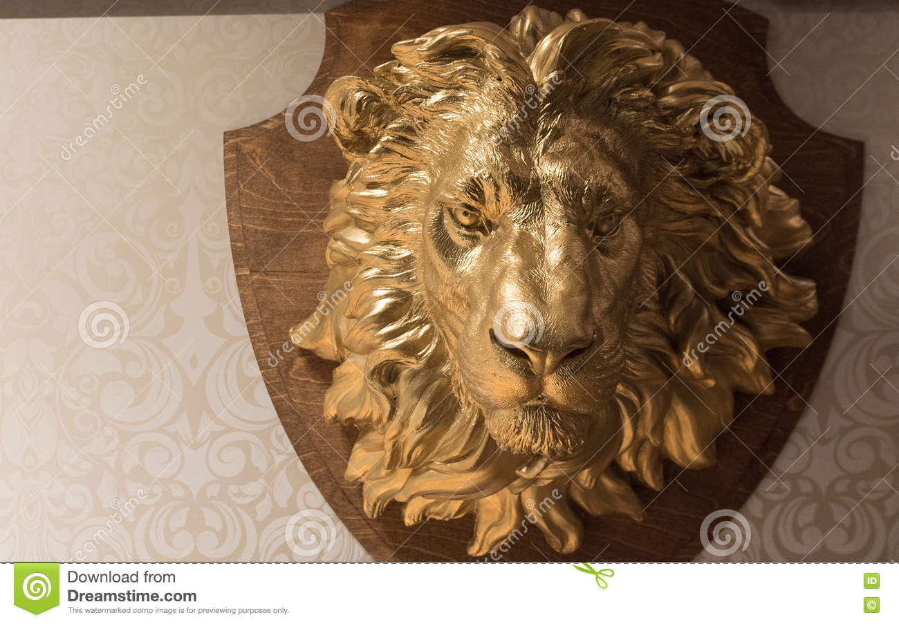 Golden Lion's Head Hunting Trophy Crest on Wallpaper Wall