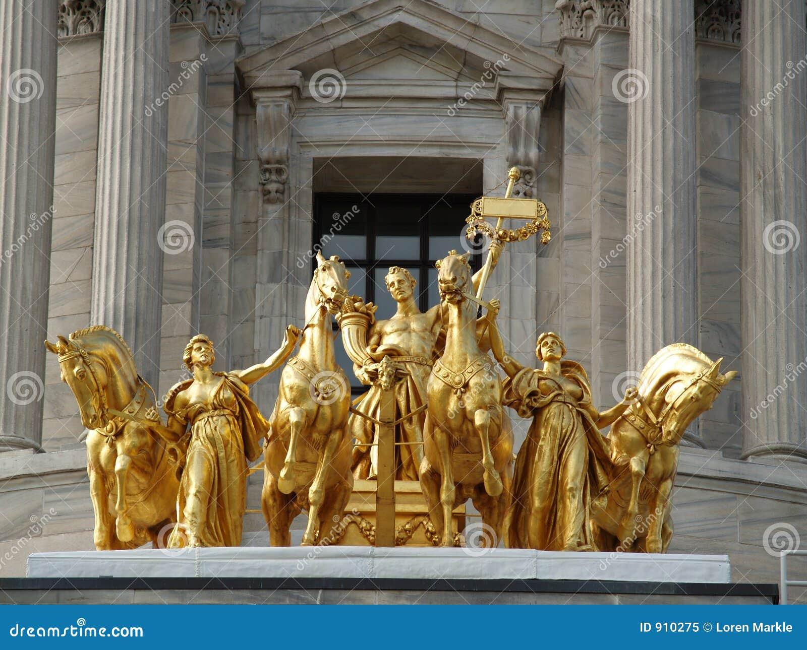 Golden mythological statue royalty free stock photo