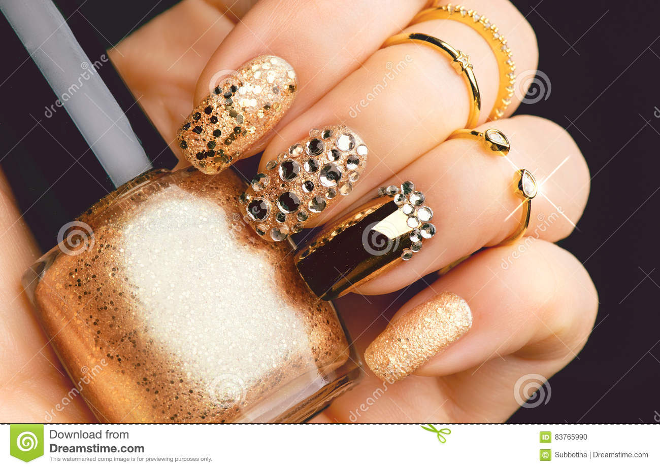 Golden Nail Art Manicure With Gems And Sparkles Stock Photo Image