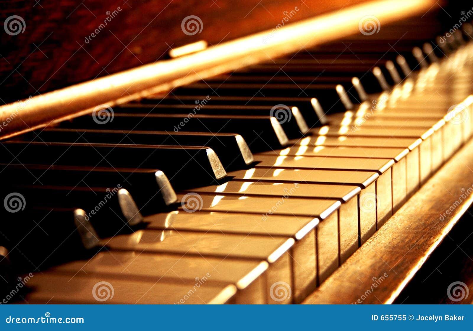Golden Piano Keys Royalty Free Stock Photo - Image: 655755