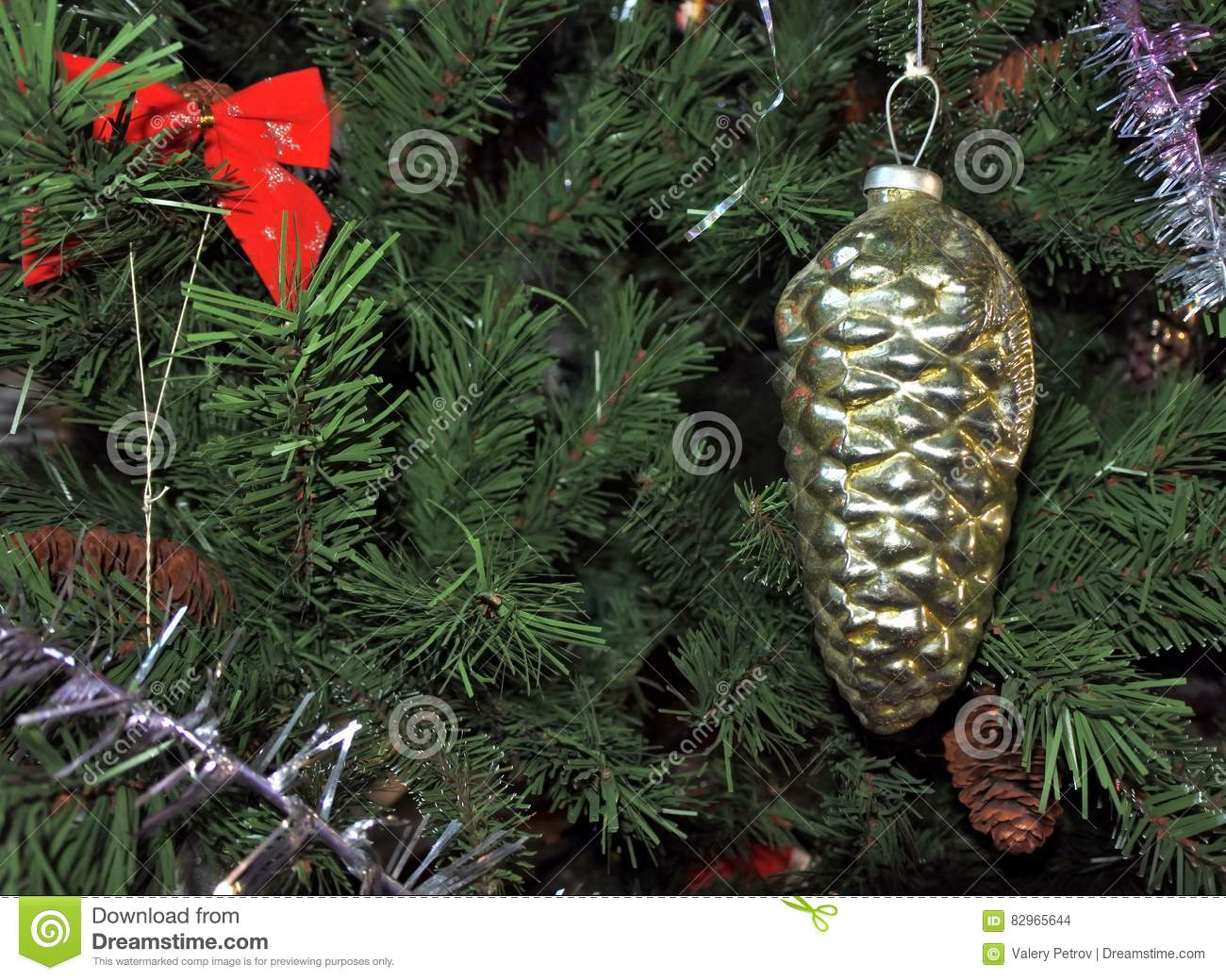 golden pine cone vintage christmas toys on new year tree background