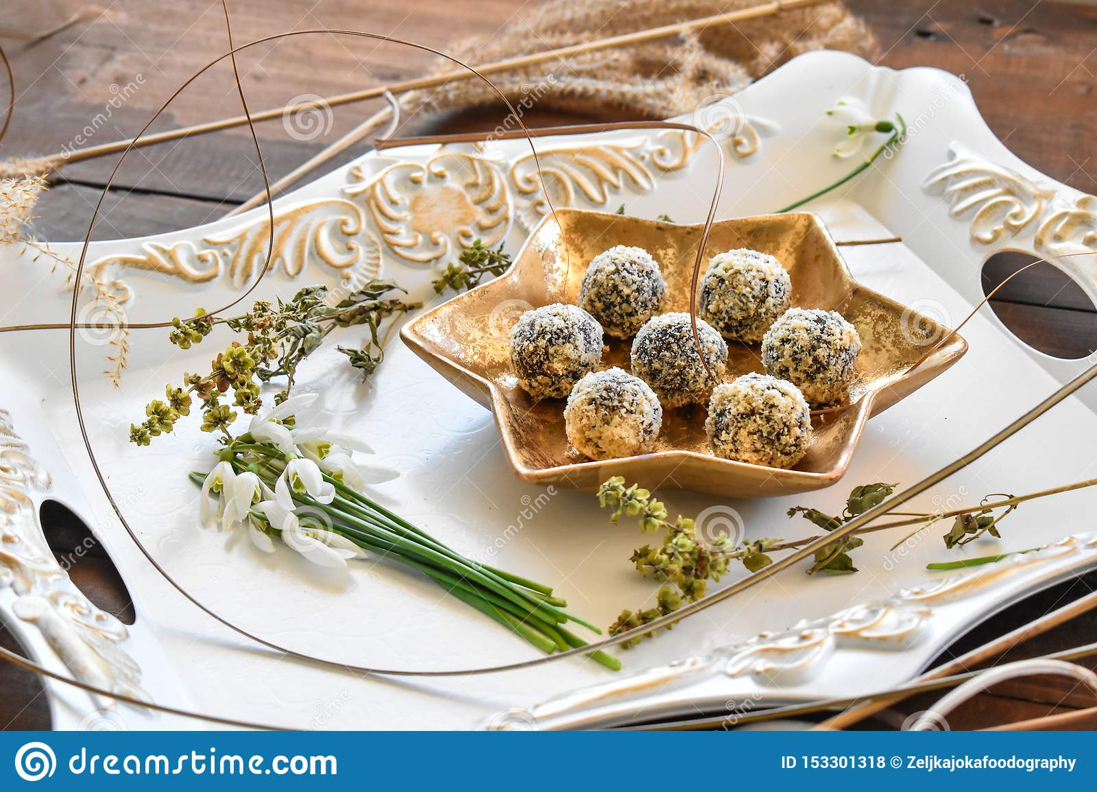 Golden plate with datepalm and walnuts chocolate balls