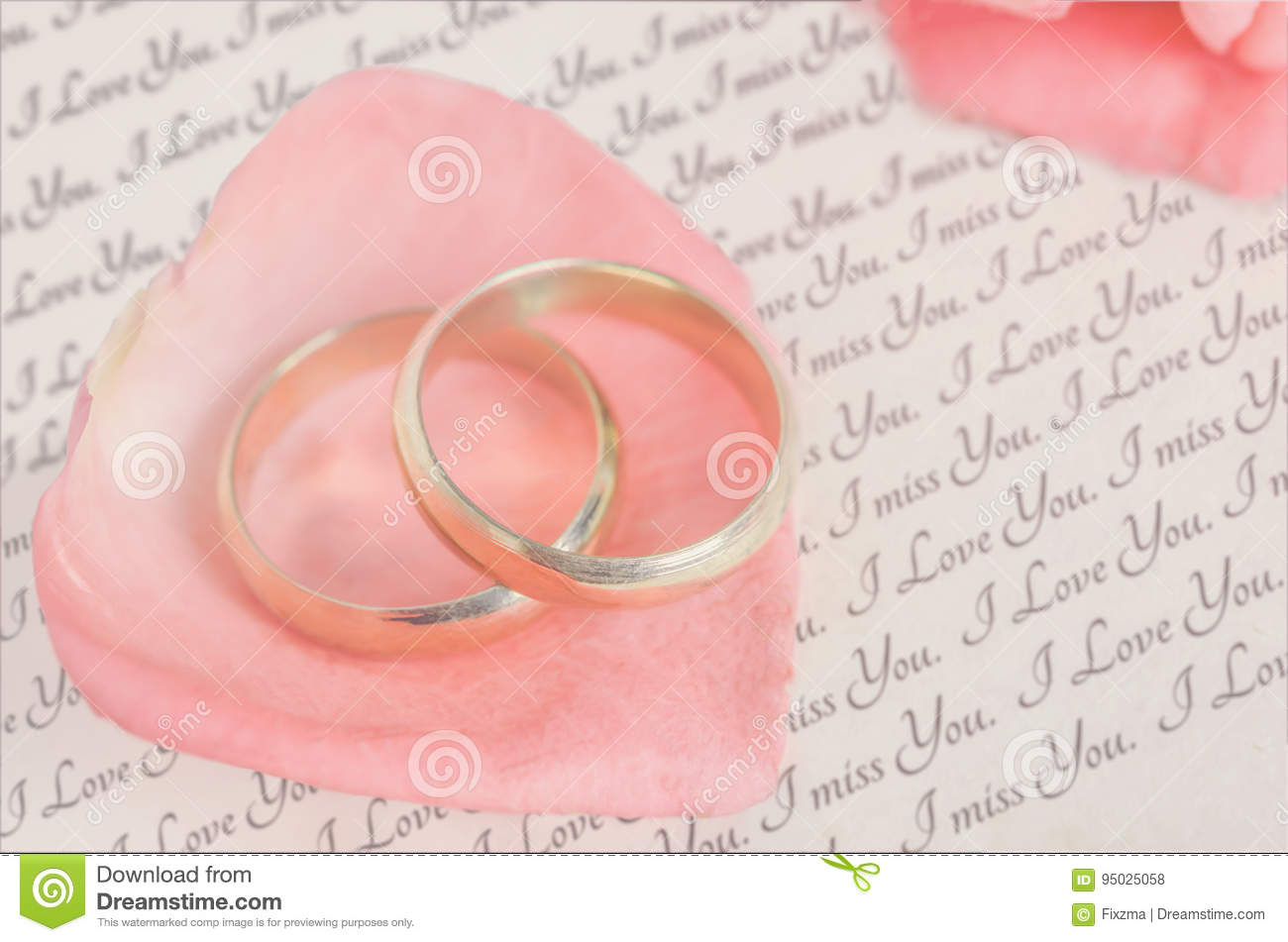 Golden Rings On Pink Rose Petal With Love Letter Stock Photo Image