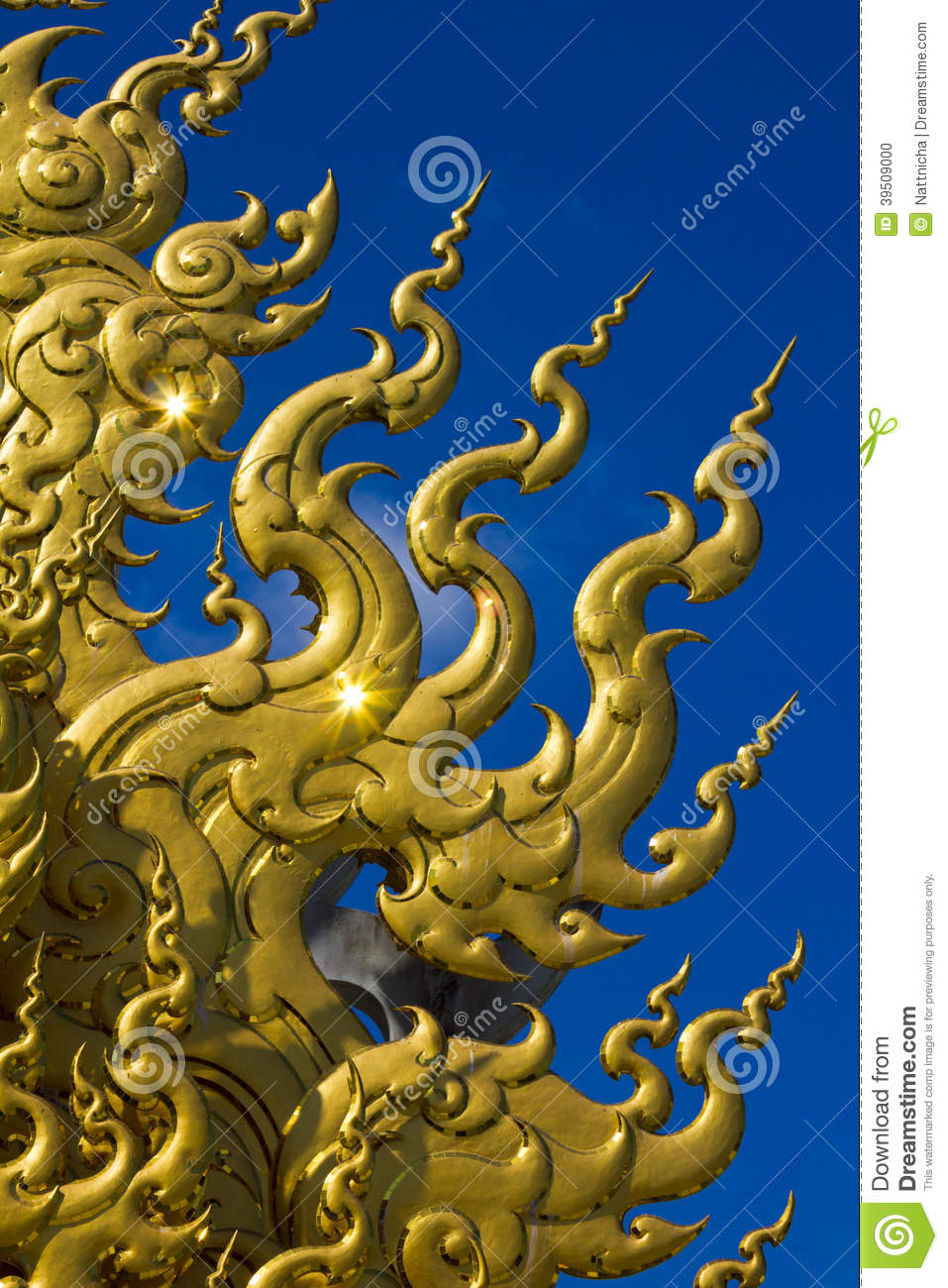 Golden sculpture at Wat Rong Khun