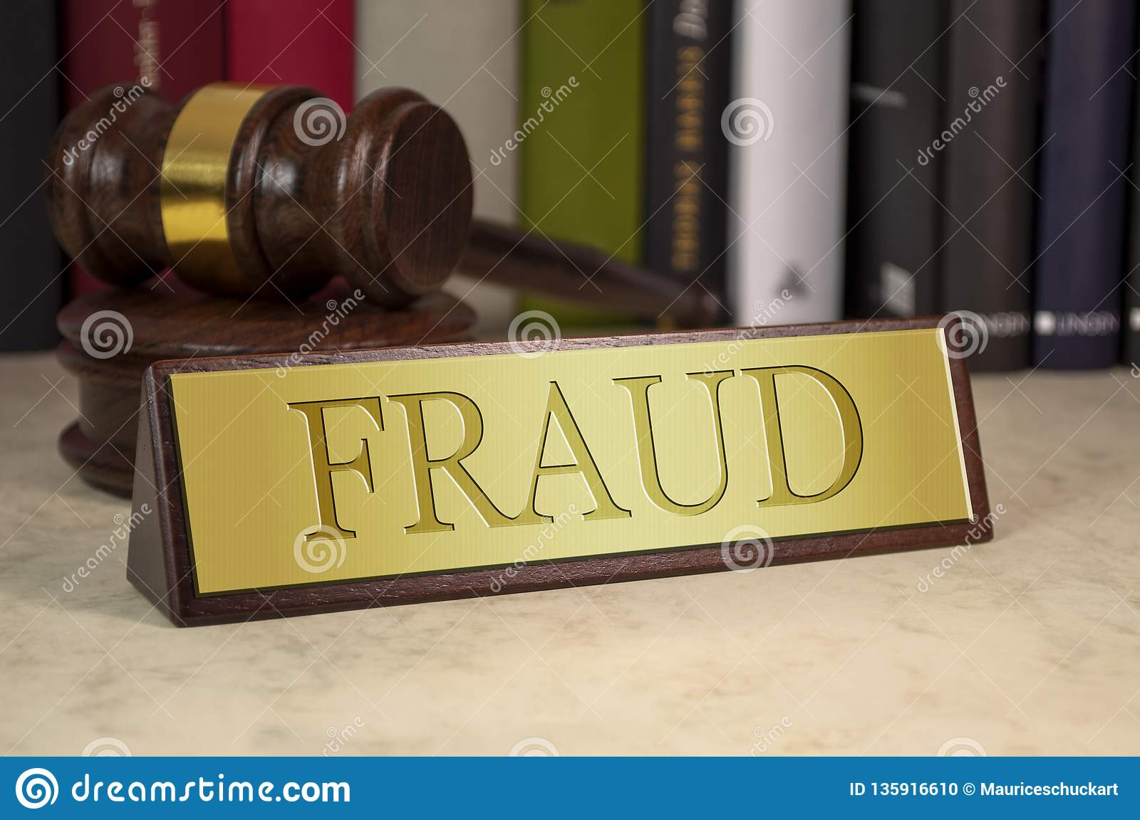 Golden sign and gavel with fraud