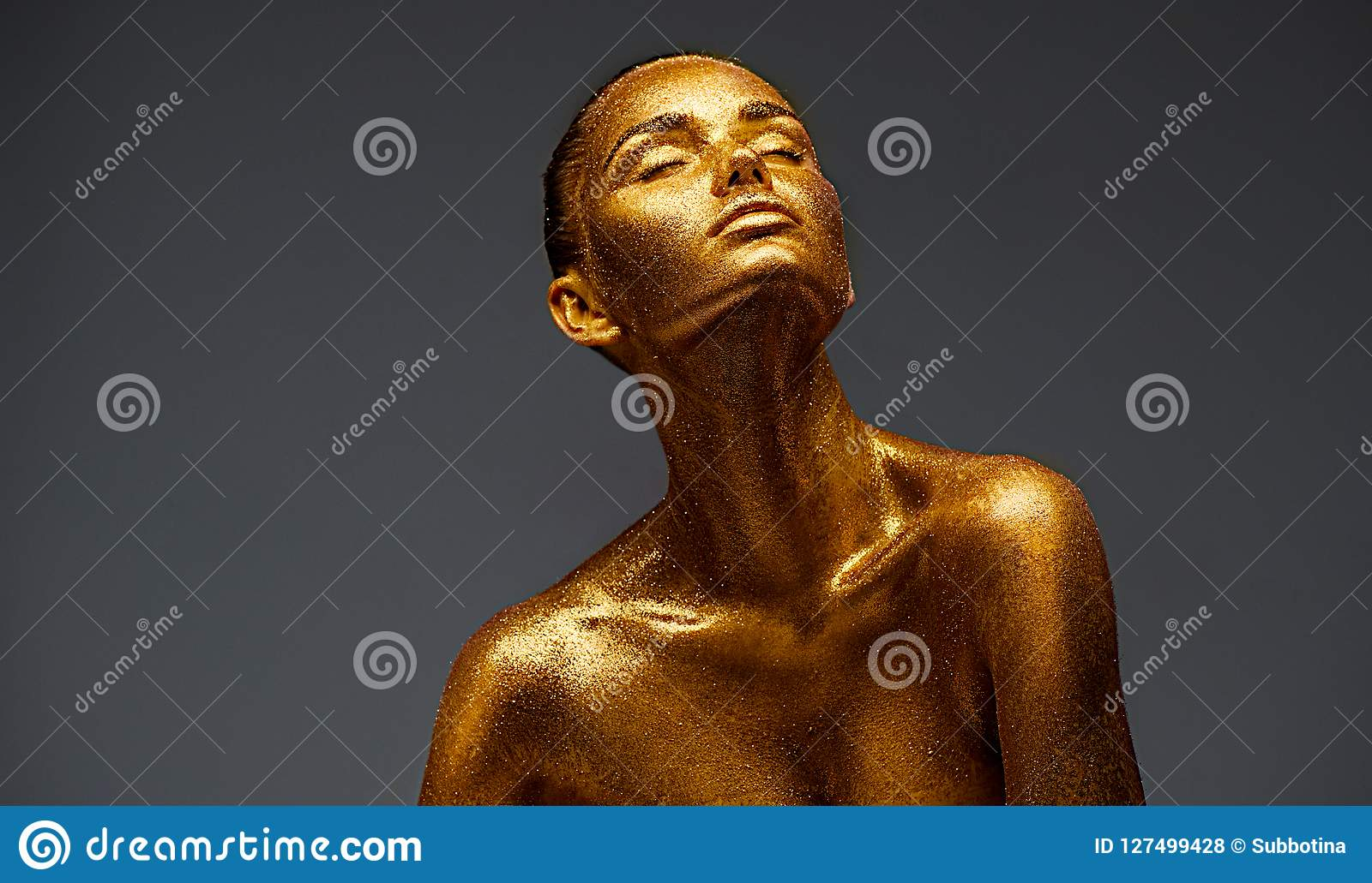 Golden skin beauty woman portrait. Fashion girl with holiday golden makeup. Body art