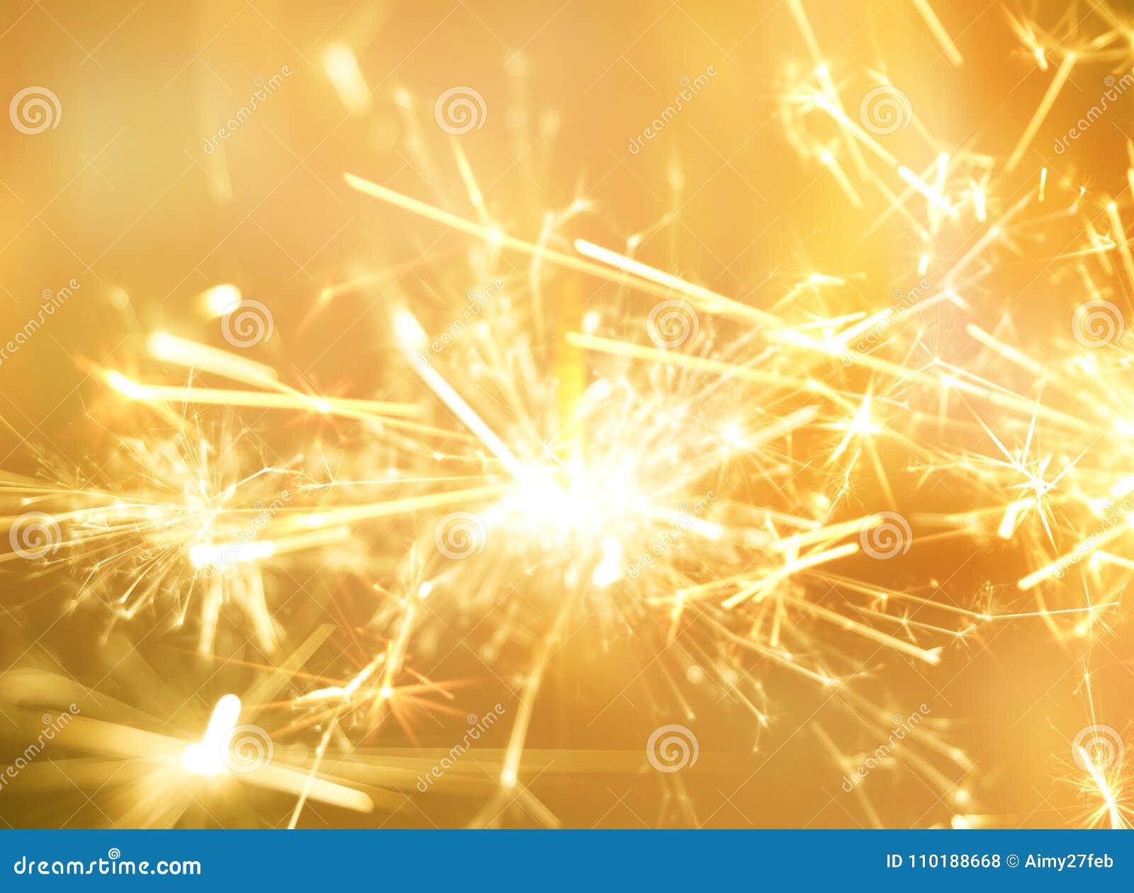 Golden sparkler fire for party celebration background.