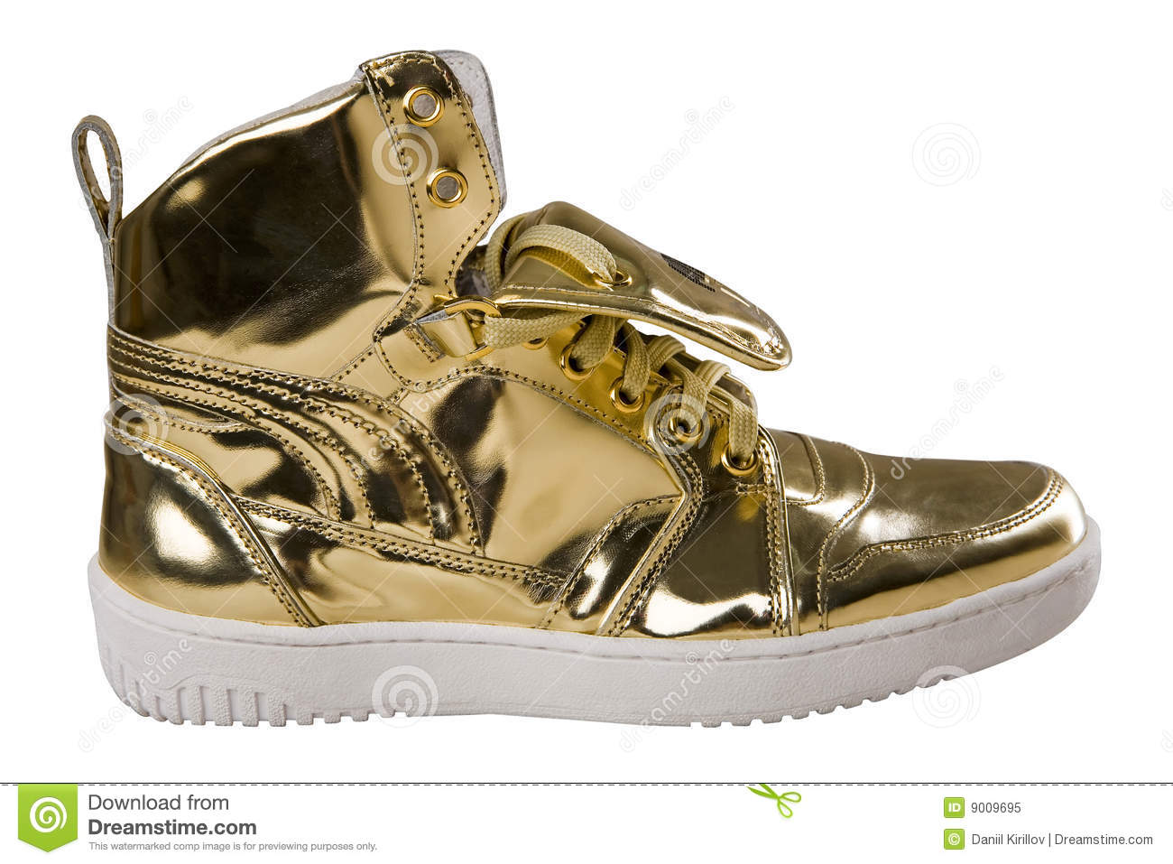 Golden sport shoes isolated on white